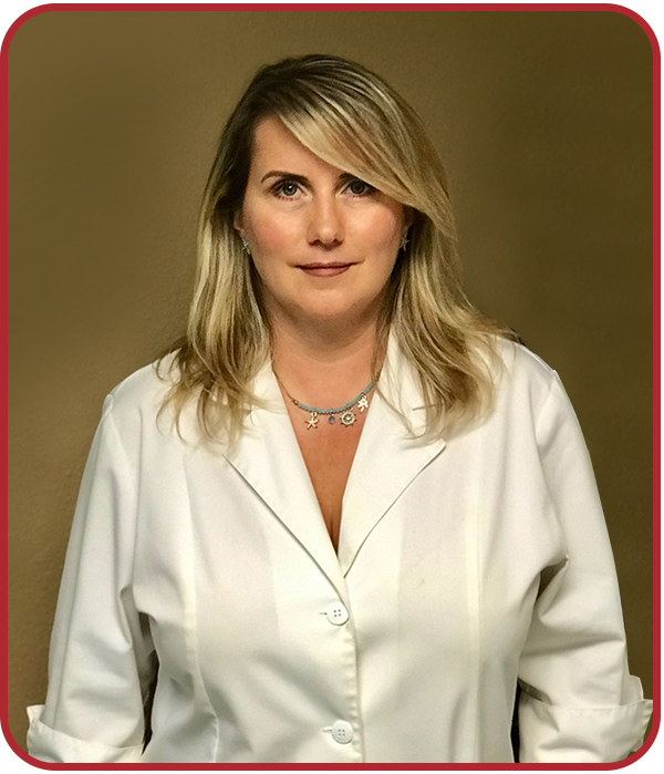 Professional headshot photograph of Nataliya in white lab coat