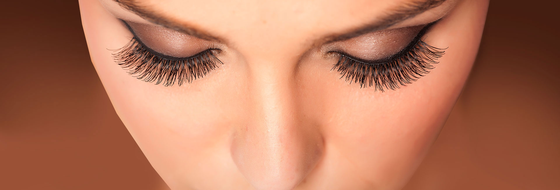 Image of a woman from above showcasing her eyelashes