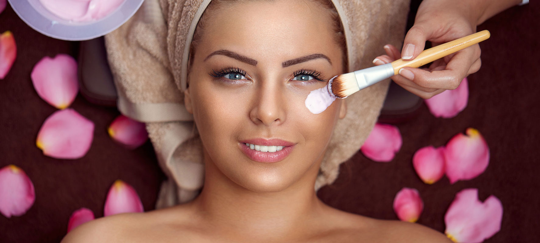 Image of a woman at a spa getting a facial