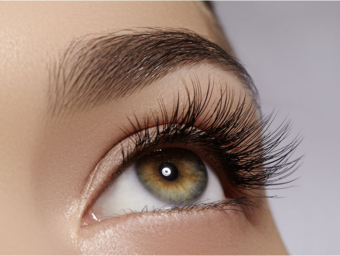 Image of a woman's eye with natural lash extensions