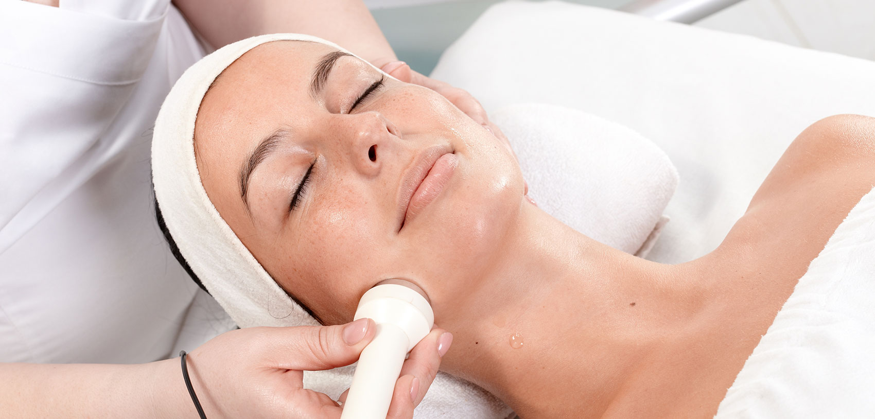 Photo of a woman receiving a skin tightening facial treatment